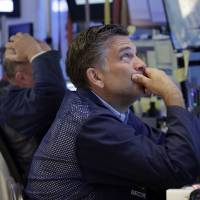 Asian stocks mostly lower as \'Brexit\' worries linger