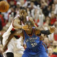Photo - Portland Trail Blazer's Marcus Camby defends against Oklahoma City Thunder's Kevin Durant in the second half during their NBA basketball game Monday, April 12, 2010, in Portland, Ore.  The Trail Blazers defeated the Thunder 103-95. (AP Photo/Rick Bowmer) ORG XMIT: ORRB109