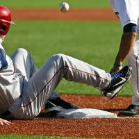 Photo - Oklahoma's Matt Oberste, left, slides into third as Connecticut's Vinny Siena loses control of the ball during an NCAA college baseball tournament regional game at English Field in Blacksburg, Va., Saturday, June 1, 2013. (AP Photo/Michael Shroyer) ORG XMIT: VAMS142