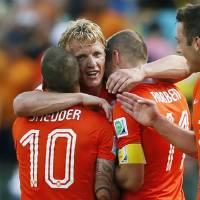 Photo - Netherlands' Arjen Robben, Dirk Kuyt and Wesley Sneijder celebrate after the World Cup round of 16 soccer match between the Netherlands and Mexico at the Arena Castelao in Fortaleza, Brazil, Sunday, June 29, 2014. The Netherlands won the match 2-1.  (AP Photo/Wong Maye-E)