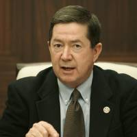 Photo - Oklahoma state Attorney General Drew Edmondson gestures as he speaks Friday, Feb. 13, 2009, at a news conference, saying that it is