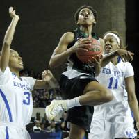 Photo - Wright State's Tay'ler Mingo, middle, looks for an opening between Kentucky's Janee Thompson (3) and DeNesha Stallworth during the first half of a first-round game in the NCAA women's college basketball tournament in Lexington, Ky., Saturday, March 22, 2014. (AP Photo/James Crisp)