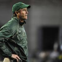 Photo - Baylor University head coach Art Briles claps for his team before the start of an NCAA college football game against Colorado Saturday, Oct. 16, 2010, in Boulder, Colo. (AP Photo/Jack Dempsey) ORG XMIT: OTKJD103