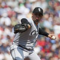 Photo - Chicago White Sox starting pitcher Hector Santiago delivers against the Minnesota Twins during the first inning of a baseball game on Sunday, Aug. 18, 2013, in Minneapolis. (AP Photo/Paul Battaglia)
