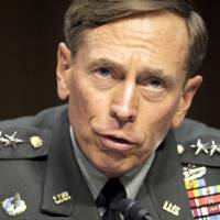 Photo -   FILE - In this June 23, 2011 file photo, then-CIA Director-desigate Gen. David Petraeus testifies on Capitol Hill in Washington. Petraeus has resigned because of an extramarital affair. (AP Photo/Cliff Owen, File)