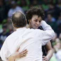 Photo - Robert Morris forward Artemis Spanou (15) is hugged by head coach Sal Buscaglia after coming out of the game in the second half against Notre Dame in a first-round game in the NCAA women's college basketball tournament, Saturday, March 22, 2014, in Toledo, Ohio. Notre Dame defeated Robert Morris 93-42. (AP Photo/Rick Osentoski)