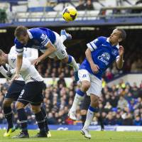 Photo - Everton's Philip Jagielka, upper left, and Leon Osman, centre right, head a ball clear during their team's English Premier League soccer match against Tottenham at Goodison Park Stadium, Liverpool, England, Sunday Nov. 3, 2013. (AP Photo/Jon Super)