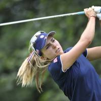 Photo - Lexi Thompson follows through on a drive on the seventh hole during the first round of the International Crown LPGA golf tournament Thursday, July 24, 2014, in Baltimore.(AP Photo/Gail Burton)