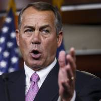 Photo - FILE - This March 26, 2014 file photo shows House Speaker John Boehner of Ohio speaking during a news conference on Capitol Hill in Washington. Capping a three-month struggle, the Senate closed in Monday on passage of election-year legislation to restore jobless benefits for the long-term unemployed that expired late last year. Approval would send the legislation to a hostile reception in the House, where majority Republicans generally oppose it.  (AP Photo/J. Scott Applewhite, File)