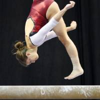 Photo - Oklahoma's Sara Stone competes on the beam during the Perfect 10 Challenge hosted by the Bart and Nadia Sports and Health Festival at the Cox Convention Center in Oklahoma City, Friday, Feb. 10, 2012. Photo by Bryan Terry, The Oklahoman