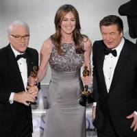 Photo - Kathryn Bigelow, center, holds her Oscars for best motion picture of the year and best achievement in directing for