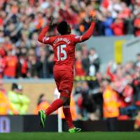 Photo - Liverpool's Daniel Sturridge celebrates after he scores the second goal of the game for his side during their English Premier League soccer match against Newcastle United at Anfield in Liverpool, England, Sunday May 11, 2014. (AP Photo/Clint Hughes)