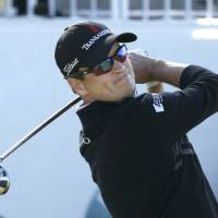 Photo - Zach Johnson watches his tee shot on the first hole during the final round of the BMW Championship golf tournament at Conway Farms Golf Club in Lake Forest, Ill., Monday, Sept. 16, 2013. (AP Photo/Charles Rex Arbogast)