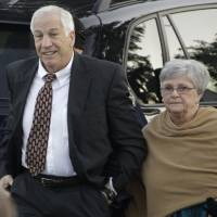 Photo - FILE - In this Dec. 13, 2011 file photo, former Penn State assistant football coach Jerry Sandusky arrives with his wife, Dottie Sandusky, for a preliminary hearing at the Centre County Courthouse in Bellefonte, Pa., where he faced his accusers. In an interview broadcast Wednesday, March 12, 2014 on NBC's