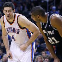 Photo - Oklahoma City's Nick Collison, left, standing with San Antonio's Tim Duncan. PHOTO BY HUGH SCOTT, THE OKLAHOMAN
