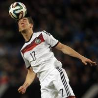 Photo - Germany's Leon Goretzka goes for a header during a friendly soccer match between Germany and Poland in Hamburg, Germany, Tuesday, May 13, 2014.  (AP Photo/Michael Sohn)