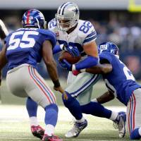 Photo -   Dallas Cowboys tight end Jason Witten (82) tackled by New York Giants cornerback Prince Amukamara (20) and Keith Rivers (55) during the second half of their NFL football game, Sunday, Oct. 28, 2012, in Arlington, Texas. The Giants won 29-24. (AP Photo/The Waco Tribune-Herald, Jose Yau)