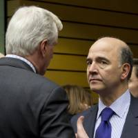 Photo - French Finance Minister Pierre Moscovici, right, speaks with European Commissioner for Internal Market Michel Barnier during a meeting of EU finance ministers in Brussels on Wednesday, Dec. 12, 2012. European Union finance ministers on Wednesday sought to agree on the creation of a single supervisor for banks across the 27-country bloc after France and Germany apparently patched up their differences over the issue. (AP Photo/Virginia Mayo)