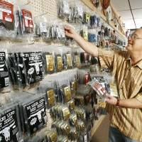 Photo - Store owner Mark Garvey at The Beef Jerky Emporium in Oklahoma City Thursday, Dec. 21, 2006, with a wall of dozens of different types of jerky. BY PAUL B. SOUTHERLAND, The Oklahoman ORG XMIT: KOD