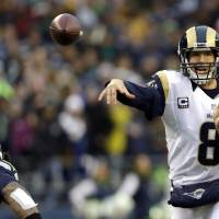 Photo - St. Louis Rams quarterback Sam Bradford passes against the Seattle Seahawks in the second half of an NFL football game, Sunday, Dec. 30, 2012, in Seattle. (AP Photo/Elaine Thompson) ORG XMIT: SEA120