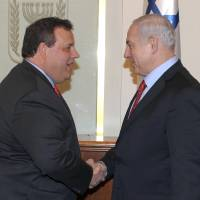 Photo -   In this photo released by the Israeli Government Press Office, Israeli Prime Minister Benjamin Netanyahu, right, shakes hands with New Jersey Gov. Chris Christie, left, during a meeting in Jerusalem, Monday, April 2, 2012. Christie kicked off his first official overseas trip to the Middle East Monday, meeting Israeli leaders in what may boost the rising Republican star's foreign policy credentials ahead of November's presidential elections. (AP Photo/ GPO, Moshe Milner) ISRAEL OUT