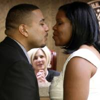 Photo - DECEMBER / DEC. 12, 2012: Daniel Reed marries Marquita Ware, both of Wichita, Kansas, in Cleveland County judge Jequita Napoli's courtroom as she performs multiple marriage ceremonies for couples who like the date 12/12/12 at the courthouse on Wednesday, Dec. 12, 2012, in Norman, Okla.  Photo by Steve Sisney, The Oklahoman