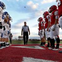 Photo - Team captains meet for the coin toss before a high school football game between the Carl Albert Titans and the Deer Creek Antlers. Photos by Steve Sisney, The Oklahoman