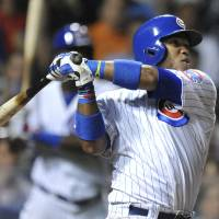 Photo - Chicago Cubs' Luis Valbuena watches his two-run home run during the eighth inning of a baseball game against the Colorado Rockies in Chicago, Wednesday, July 30, 2014. (AP Photo/Paul Beaty)