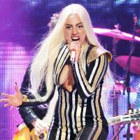 """Photo - FILE - This Dec. 15, 2012 file photo shows singer Lady Gaga performing at the Prudential Center in Newark, N.J. Lady Gaga says she's completed surgery to fix her hip. The singer posted on her blog late Wednesday that she had hip surgery and that it """"happened so fast."""" She canceled her"""