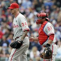 Photo - Philadelphia Phillies starter A.J. Burnett, left, talks with catcher Carlos Ruiz during the first inning of a baseball game against the Chicago Cubs in Chicago, Sunday, April 6, 2014. (AP Photo/Nam Y. Huh)