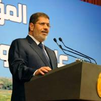 Photo - In this Monday, June 10, 2013, photo released by the Egyptian Presidency, Egypt's President Mohammed Morsi speaks on Ethiopia's Nile dam project at a conference in Cairo. Morsi on Monday hardened his stance against Ethiopia and its construction of a Nile dam, warning that