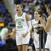 Photo - Notre Dame's Kayla McBride (21) reacts after making a basket against Duke during the second half of the NCAA college basketball championship game of the Atlantic Coast Conference tournament in Greensboro, N.C., Sunday, March 9, 2014. (AP Photo/Chuck Burton)