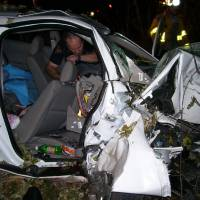 Photo -   Police investigate the wreckage of a 2005 Chevrolet Cobalt that crashed in St. Croix County, Wis., killing Natasha Weigel, 18, and Amy Lynn Rademaker, 15, and injuring the 17-year-old driver, Megan Ungar-Kerns.  AP File Photo   Uncredited -  AP