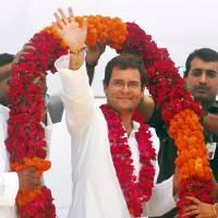 Photo - FILE – In this April 18, 2009 file photo, Congress party General Secretary Rahul Gandhi waves to the crowd as he is felicitated by party workers with a garland during an election rally in Amethi, India.   Gandhi was appointed Vice President of the party at a special two-day long party seminar on Saturday, Jan. 19, 2013. (AP Photo/Manish A., File)