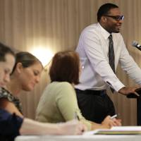 Photo - In this Thursday, Oct. 11, 2012, photo, a panel of Spirit Airlines employees make notes and listen as applicant Anthony Williams, top right, addresses a room full at a Flight Attendant Open House, in Dallas. The airline announced that it is hiring 250 positions that include flight attendants, pilots and mechanics to be based out of its newly announced crew base at Dallas-Fort Worth International Airport.  U.S. employers advertised more job in October than September, a hopeful sign that hiring could pick up in the coming months. (AP Photo/Tony Gutierrez)