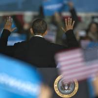 Photo -   President Barack Obama turns to acknowledge supporters behind him after speaking at a campaign event at the Franklin County Fairgrounds, Friday, Nov. 2, 2012, in Hilliard, Ohio, before heading to another campaign stop in in Springfield, Ohio. (AP Photo/Carolyn Kaster)