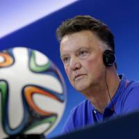 Photo - Netherlands' head coach Louis van Gaal attends a press conference the day before the group B World Cup soccer match between Spain and the Netherlands at the Arena Ponte Nova in Salvador, Brazil, Thursday, June 12, 2014. (AP Photo/Wong Maye-E)