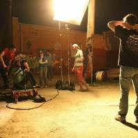 Photo - Producer/director Kyle Roberts, center, works with his crew in Oklahoma City?s Automobile Alley during a recent night shoot for the Oklahoma-made coming-of-age superhero movie, ?The Posthuman Project.? Photo provided by Reckless Abandonment Pictures