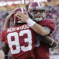 Photo -   Alabama quarterback AJ McCarron (10) celebrates with receiver Kevin Norwood after throwing him a 7 yard touchdown pass during the first half of a NCAA college football game against Auburn at Bryant-Denny Stadium in Tuscaloosa, Ala., Saturday, Nov. 24, 2012. (AP Photo/Dave Martin)