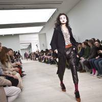 Photo - A model wears a design created by Vivienne Westwood during London Fashion Week, at the Saatchi Gallery in West London, Sunday, Feb. 17, 2013. (Photo by Joel Ryan/Invision/AP)