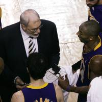 Photo - Los Angeles Lakers head coach Phil Jackson, left, and guard Kobe Bryant, right, confer during a timeout in the fourth quarter during Game 2 of the NBA basketball finals against the Boston Celtics in Boston, Sunday, June 8, 2008. Boston won 108-102.(AP Photo/Charles Krupa) ORG XMIT: BXG221