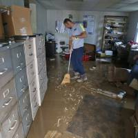 24 dead in West Virginia floods; search and rescue continues
