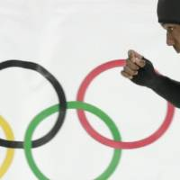 Photo - Shani Davis of the U.S. competes in the second heat of the men's 500-meter speedskating race at the Adler Arena Skating Center during the 2014 Winter Olympics, Monday, Feb. 10, 2014, in Sochi, Russia. (AP Photo/Matt Dunham)