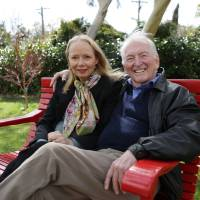 Photo -   In this Aug. 30, 2012 photo provided by Penguin Books, Australian best-selling author Bryce Courtenay poses with wife Christine Gee on a park bench in Canberra Australia Courtenay, author of