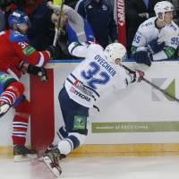 Photo -   Alexander Ovechkin, right, from Dynamo Moscow collides with Zdeno Chara from Lev Praha during their KHL ice hockey match in Prague, Czech Republic, Tuesday, Oct. 9, 2012. Chara and Ovechkin are among those NHL players who were signed by European clubs because of the NHL lockout. (AP Photo/Petr David Josek)