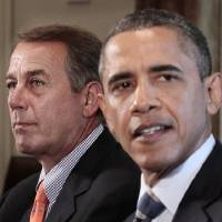 Photo - FILE - In this July 7, 2011 file photo, House Speaker John Boehner, of Ohio, listens at left as President Barack Obama speaks during a meeting with Congressional leadership to discuss the debt in the Cabinet Room of the White House in Washington. In the heated talk about deep spending cuts that will dominate Congress in the coming weeks, one thing is likely to be in short supply: details. The reason is simple. Americans embrace the general, abstract idea of reducing federal spending. Their support quickly fades, however, when specific programs are targeted. (AP Photo/Pablo Martinez Monsivais, File)