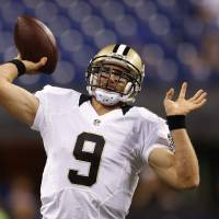 Photo - New Orleans Saints quarterback Drew Brees throws before an preseason NFL football game against the Indianapolis Colts in Indianapolis, Saturday, Aug. 23, 2014. (AP Photo/Sam Riche)