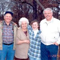 Photo - Cathy Byus seen in a 1996 photograph with her father and grandparents.  Photo provided