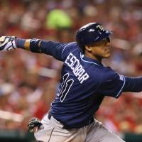 Photo - Tampa Bay Rays' Yunel Escobar drives in two runs with a ground-rule double in fifth inning againast the St. Louis Cardinals in a baseball game Tuesday, July 22, 2014, in St. Louis. The Rays won 7-2. (AP Photo/St. Louis Post-Dispatch, Chris Lee)