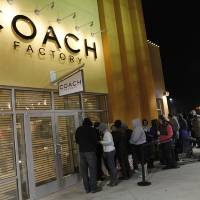 Photo - Customers wait outside of the Coach Factory store during Black Friday 2011 at The Outlet Shoppes at Oklahoma City. Photo by Garett Fisbeck, The Oklahoman  Garett Fisbeck